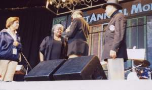 With tears of joy, Dorothy receives the first ever Lifetime Achievement award from Director Lee Durley of the Monterey Bay Blues Festival.  Director Julie Paisant and KGO radio personality Ray Taliaferro watch the presentation.  Also, unveiled after the June 24 performance was a large painting of Dorothy Moore.